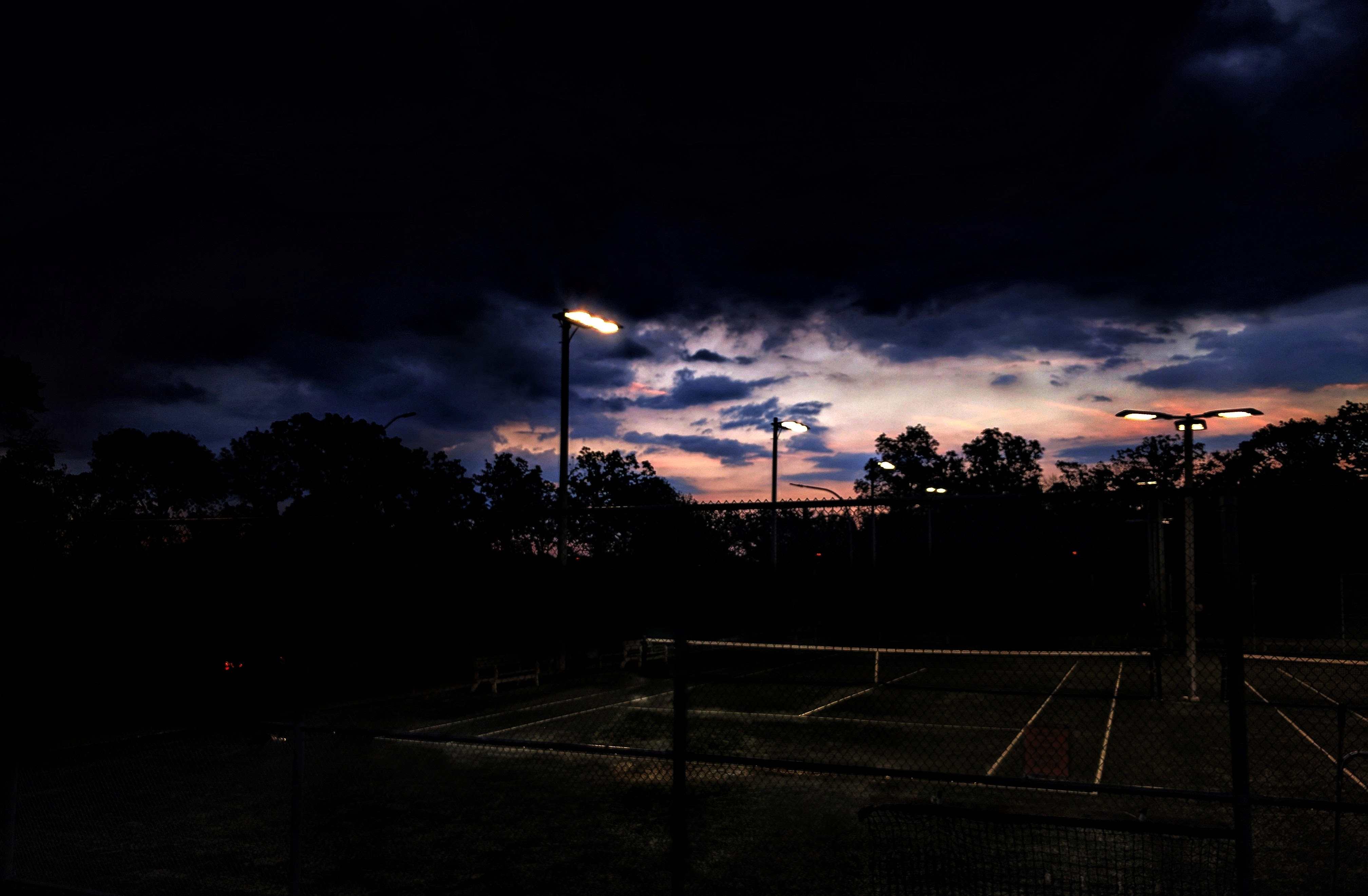 Dark clouds over a tennis court